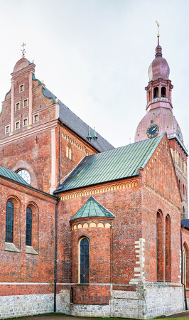 Corner of the Riga Cathedral in the old town of Riga, Latvia. The cathedral was built near the river Daugava in 1211. Nowadays it is the Evangelical Lutheran cathedral where sits Archbishop of Riga.