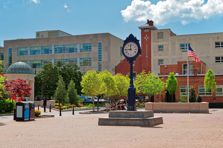 Washington D.C., USA - May 2, 2015: Clock statue is located in the campus of the George Washington University in the place Kogan Plaza. Also, the Gelman Library is situated near that place. Editorial