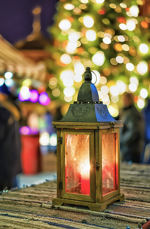 christmas market: Bright candle lantern in the centre of the Christmas Market in Riga, Latvia. Market took place from the late November till the beginning of January. Selective focus