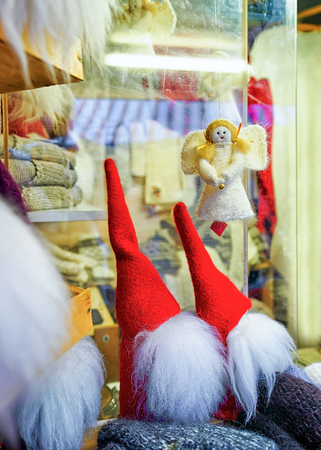 Riga, Latvia: Small statues of angels and gnomes at the Riga Christmas Market in Latvia. Market takes place from beginning of December. Selective focus
