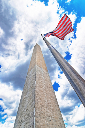 Washington DC, USA - May 2, 2015: Monument of the first american president George Washington. The statue is located in Washington D.C., United States. The monument is made of granite and marble Editorial