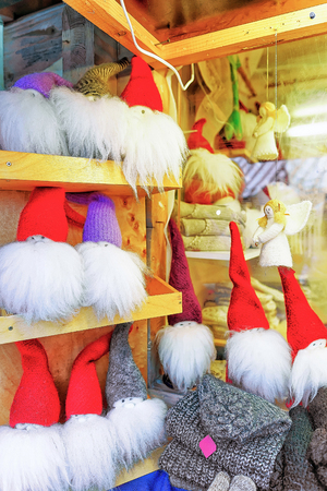 Riga, Latvia: Little statues of angels and gnomes at one of the stalls during the Christmas Market in Riga, Latvia. The market is annual and takes place through the whole December