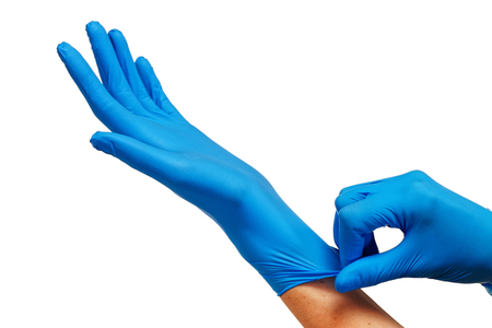 Doctor putting on protective blue gloves isolated on white background Archivio Fotografico