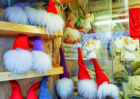 christmas toys: Riga, Latvia: Little angel and gnome statues at the Christmas Market in Riga, Latvia. Angels and gnomes are one of the main symbols of Christmas spirit. Selective focus