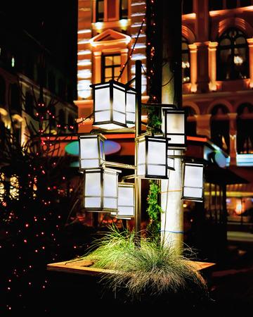 christmas market: Lanterns illuminated with light at Riga Christmas Market in Riga, Latvia, in the evening Stock Photo