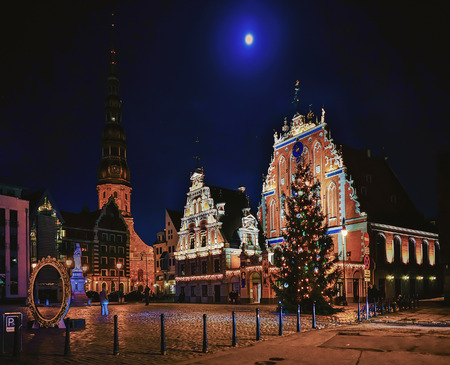 Riga, Latvia - December 24, 2015: House of the Blackheads and the Christmas tree near it during the Christmas market in Riga, Latvia at night