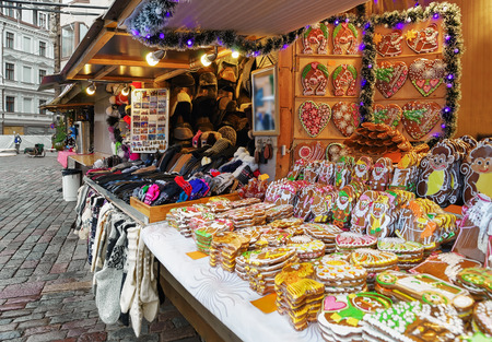 christmas market: One of the most traditional sweet treats which are gingerbreads pictured at the Christmas Market in Riga in Latvia. They can be found in different sizes and icing.