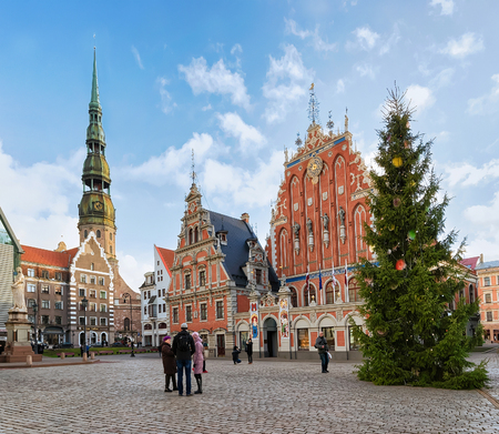 guild hall: Riga, Latvia - December 26, 2015: People at the House of the Blackheads and the Christmas tree near it during the Christmas season in Riga, Latvia