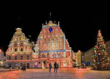 Riga, Latvia - December 24, 2015: House of the Blackheads and the Christmas tree near it during the Christmas in Riga, Latvia at night