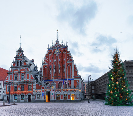 Riga, Latvia - December 26, 2015: House of Blackheads and the Christmas tree near it during the Christmas season in Riga, Latvia