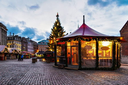 Bright pavilion at the Christmas market located at Dome square in old Riga, Latvia. The market takes place each year from December till the beginning of January. It locates across the whole old town.