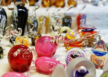 Small glass figurines displayed for sale at the Christmas market in old Riga, Latvia. The market takes place from the beginning of December till the start of January each year. Stock Photo