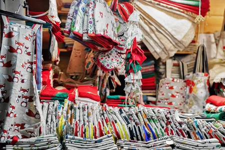 festively: Festively ornamental and handmade linen materials presented for sale at the Christmas market in Riga, Latvia. At the fair people can also buy souvenirs, goods, warm clothes and traditional food.