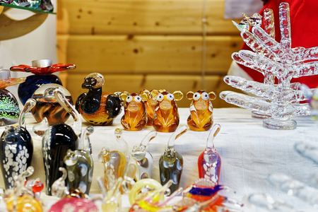 Monkey figures as the symbol of the upcoming year and other glass statues displayes for sale at the Christmas market in Riga, Latvia. It can be a great gift for friends and relatives. Stock Photo