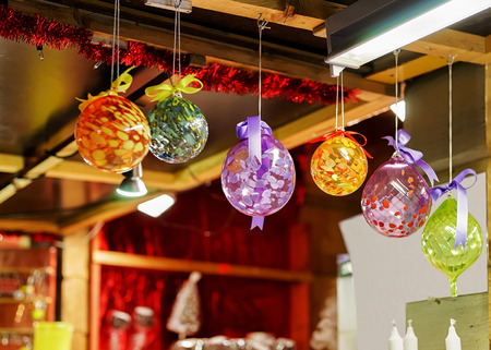 pellucid: Bright and colorful balls hanging at one of the stalls during the Christmas market in old Riga, Latvia. They can serve as the decorations for the Christmas tree and house. Stock Photo