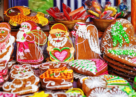 festively: Riga, Latvia: Festively colored gingerbreads at the stall during the Christmas market in Riga, Latvia. Selective focus Stock Photo