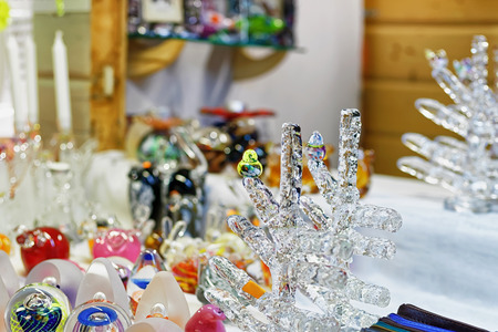 christmas market: Glass figurines and tree displayed for sale at the Christmas market in old Riga, Latvia. Such small souvenirs can be a great present for your family or friends during Christmas or New Year.