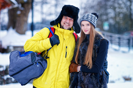 fellow: Young girl and fellow in winter in Trakai in Lithuania. Stock Photo