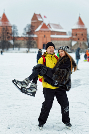fellow: Young girl and fellow at the winter rink covered with snow in Trakai in Lithuania. Stock Photo