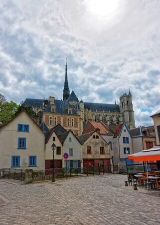 Amiens Cathedral of Notre Dame and traditional houses on Rue de Don Street at the embankment of Somme canal, Picardy, France
