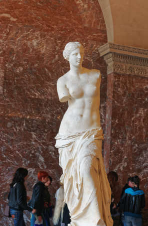 Paris, France - May 4, 2012: Aphrodite of Milos sculpture at Louvre museum in Paris in France. People of the background.