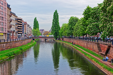 Bridge over Canal du Faux-Rempart in the Grande Ile historic center of Strasbourg, in France. People on the background