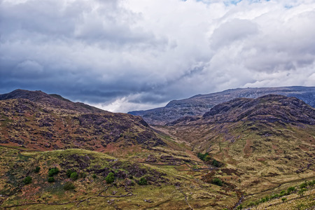 snowdonia: Beautiful Panoramic view to chain of mountains in Snowdonia National Park in North Wales of the United Kingdom. Snowdonia is a mountain range and a region in North of Wales. Stock Photo