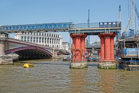 Blackfriars Bridge in London in England. This bridge is a railway one and is called as well as Charing Cross Bridge. Construction works in process