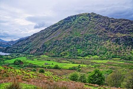 Beautiful Panoramic view of chain of mountains in Snowdonia National Park in North Wales of the United Kingdom. Snowdonia is a mountain range and a region in North of Wales.