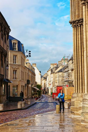 Bayeux, France - May 8, 2012: Street at Cathedral of Our Lady of Bayeux in Calvados department of Normandy, France. People on the background.