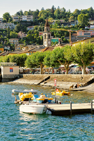 Boats at the embankment in Ascona luxurious resort on Lake Maggiore in Ticino canton in Switzerland. Stock Photo