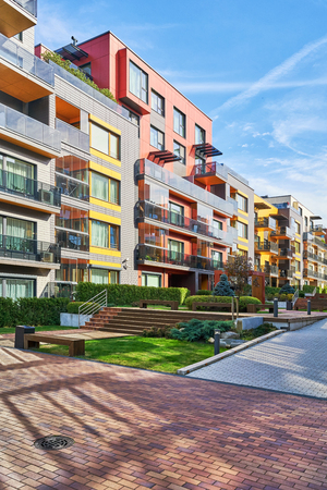 Benches and Modern complex of apartment residential buildings. With other outdoor facilities.