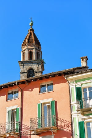 St Peter and Paul church tower and colorful buildings at the luxurious resort of Ascona on Lake Maggiore, Ticino canton in Switzerland.