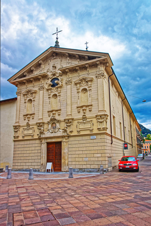 aristocracy: Church of St Rocco in the city center of luxurious resort Lugano in Ticino canton of Switzerland. People on the background.