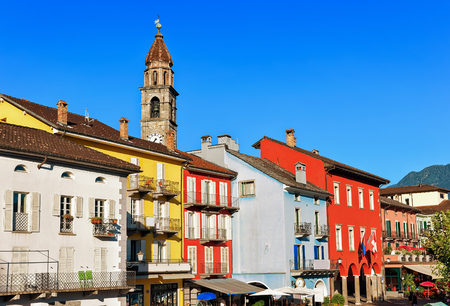 St Peter and Paul church tower  and facades of buildings at the luxurious resort in Ascona on Lake Maggiore in Ticino canton in Switzerland. Stock Photo