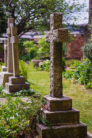 Crosses at churchyard cemetery at Bristol Cathedral in Bristol in South West of the UK. It is fully called as Cathedral Church of the Holy and Undivided Trinity.  Stock Photo