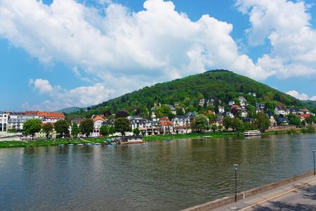 Embankemnt of Neckar river in Heidelberg in  Baden-Wurttemberg in Germany. People on the background