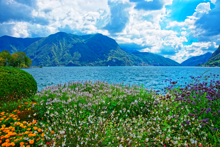 Garden park at the promenade of the luxurious resort in Lugano on Lake Lugano and Alps mountains of Ticino canton, Switzerland. Stock Photo