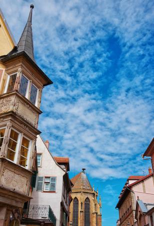 haut rhin: Rue de Eglise Street and fragment of St Martin Church in Colmar, Haut Rhin at Alsace, of France. Stock Photo