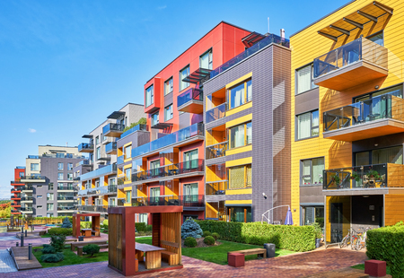 Modern complex of apartment residential buildings. With benches and outdoor facilities.