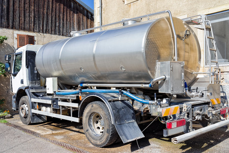 creamery: Evillers, France - August 31, 2016: Liquid storage tank car for the milk in the dairy for the production of Gruyere de Comte Cheese in Franche Comte, Burgundy, France.