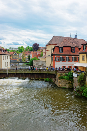 the little venice: Bamberg, Germany - May 9, 2013: Old Houses at Regnitz River in the Little Venice in Bamberg in Upper Franconia, Bavaria, Germany. People on the background