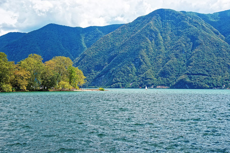 Nature of Lake Lugano and mountains in Lugano in Ticino canton of Switzerland.