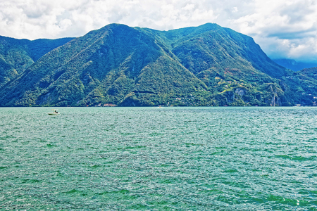 Nature of Lake Lugano and mountains in Lugano in Ticino canton Switzerland.