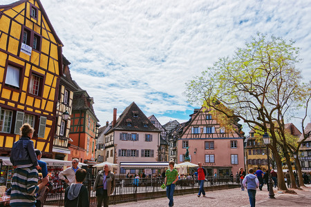 Colmar, France - May 1, 2012: Old city center at Place de Ancienne Douane Square with Schwendi fountain in Colmar, Haut Rhin in Alsace, in France. People on the background