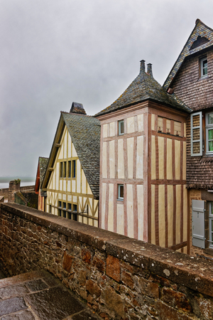 manche: Old Houses in Mont Saint Michel of Normandy region at Manche department in France. Stock Photo
