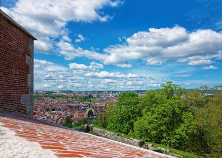 church steeple: Old city and roofs with the tower of citadel of  Besancon in Bourgogne Franche Comte region in France. Stock Photo