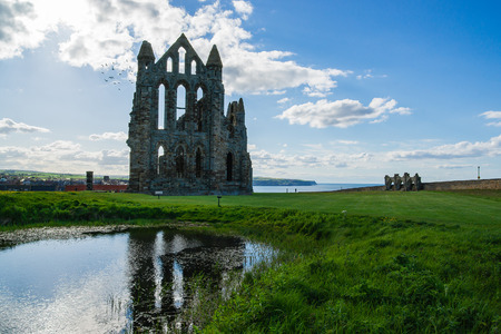 abbey ruins abbey: Ruins of Whitby Abbey in North Yorkshire in the UK. It is ruins of the Benedictine abbey. Now it is under protection of the English Heritage.