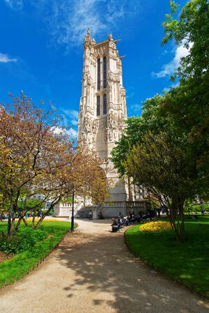 Paris, France - May 3, 2012: Saint Jacques Tower in Rivoli Street in central Paris, France. People on the background