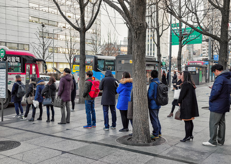 jung: Seoul, South Korea - March 11, 2016: People staying in the queue waiting for the bus in Jung district in Seoul, South Korea Editorial